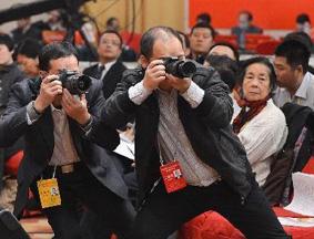 聚焦十八大:记者百态