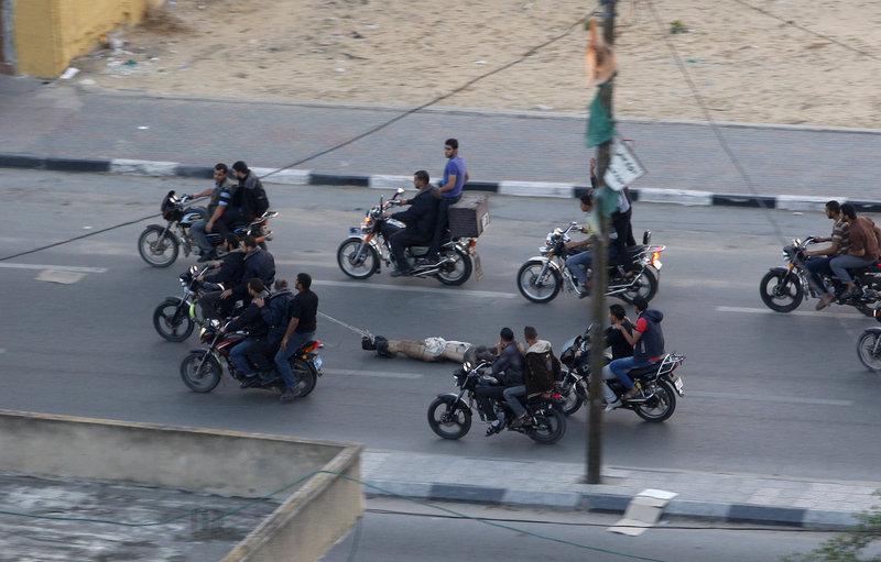 哈马斯处决以色列间谍拖尸体游街 -  红杏 - 红杏