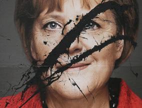 德国总理默克尔竞选照片遭恶意毁坏