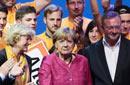 默克尔三度出任德国总理 把男人分两种