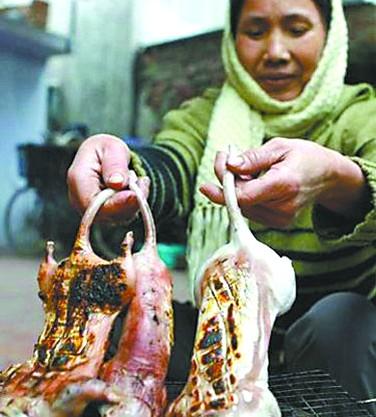 越南人吃烤鼠肉美容