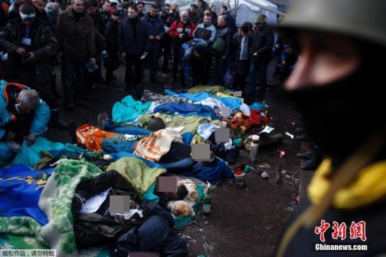 乌克兰总统宣布全国哀悼日 悼念首都骚乱遇难者