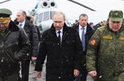 普京冒雪观摩俄西部军区军演