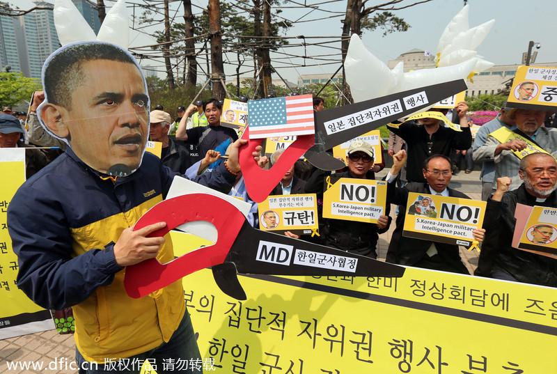 韩国民众游行抗议奥巴马来访 上万名警察维持秩序