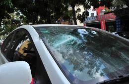 """三亚发生打砸事件 10余辆车多个店铺""""受伤"""""""