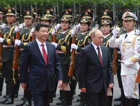 习近平举行仪式欢迎俄罗斯总统普京访华