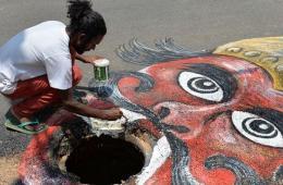 印艺术家井口创作死神涂鸦 提醒当局改善基础设施