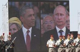 """奥巴马普京屏幕会面尴尬一笑 观众""""起哄"""""""