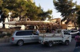 伊反政府武装举行阅兵 飞毛腿导弹被曝光引质疑