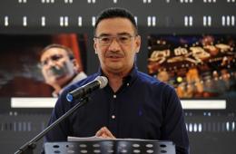 MH370图片展举行 马来西亚防长希沙姆丁主持