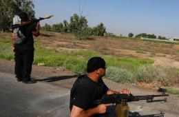 伊拉克政府军志愿者与逊尼派武装分子交战