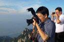 为何有官员爱称自己是摄影家