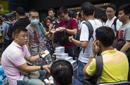 舆论解读中国人为何疯抢iPhone 6