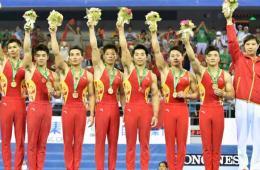 体操世锦赛中国0.1分险胜日本夺冠 创六连冠纪录