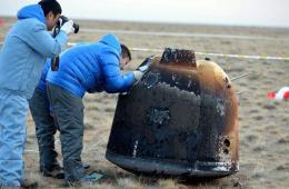 我国探月飞行试验器返回器成功在预定区域降落