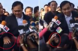 泰国总理被批当众冒犯男记者:拍头拧耳朵