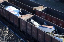 MH17残骸从坠机地运出 共约100吨残片