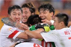 中国国足逆转取两连胜 小组第一出线