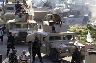 伊拉克军队悍马车顶上装遮阳棚