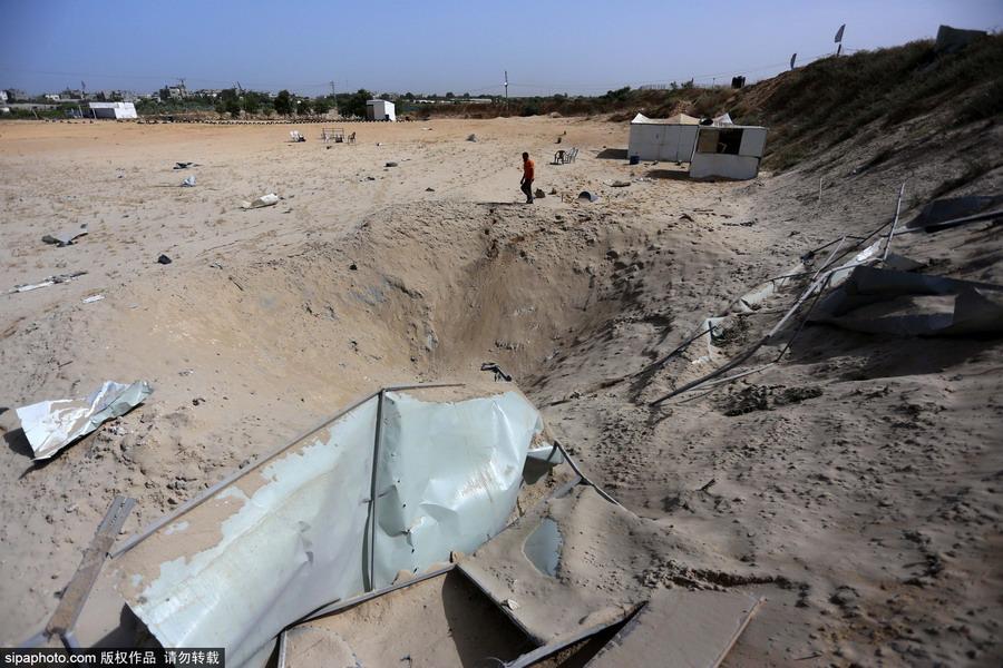 以色列空袭加沙地带_以色列空袭加沙地带 巴勒斯坦民众开始清理废墟_国际新闻_环球网