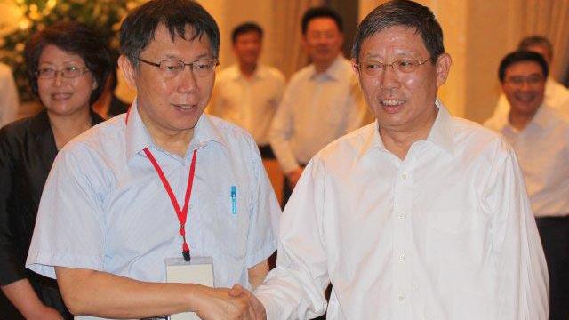上海市长杨雄高规格会见台北市长柯文哲