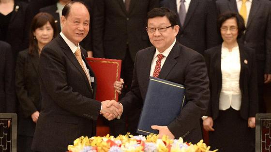 陈德铭与林中森举行两会第11次会谈 签署两项协议