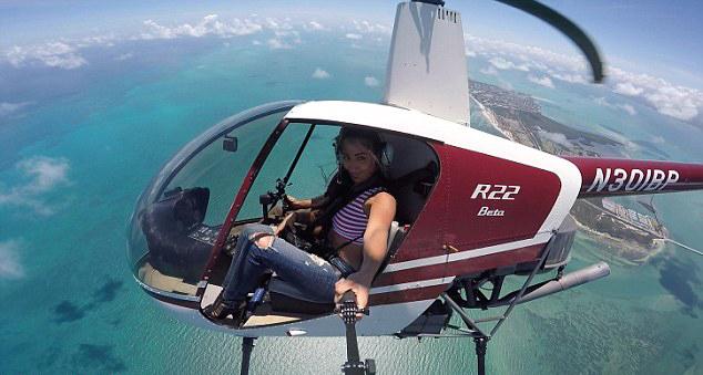 美女摄影师辞高薪工作专注高空摄影高清图片