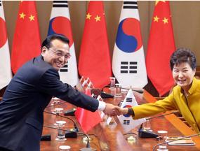 李克强谈访韩:有种到邻居家串门聊天的亲切感