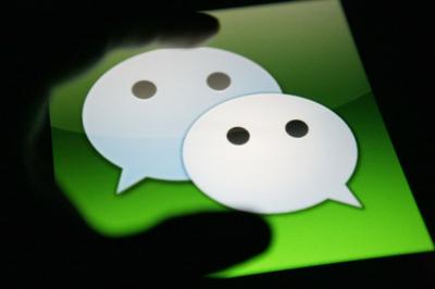 西联汇款将通过腾讯控股的微信提供移动支付服务