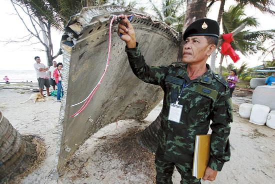 巴帕喃/泰南海滩金属物体或非马航飞机MH370遗骸