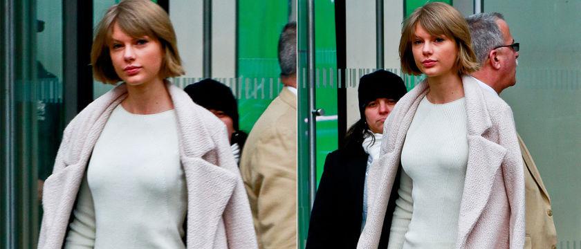 泰勒·斯威夫特穿粉色大衣上围凸显