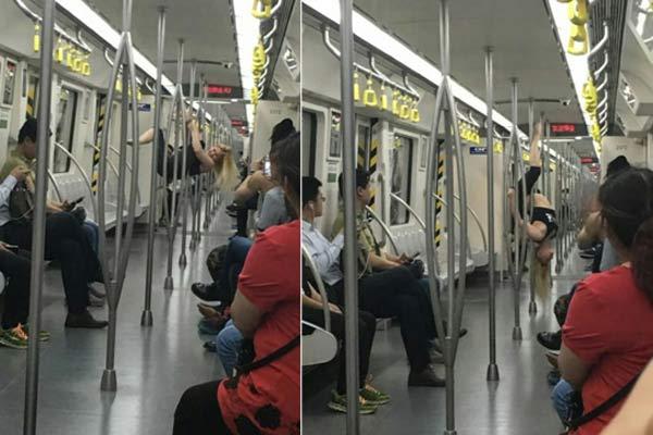 外国女孩天津地铁车厢内跳钢管舞 乘客看呆
