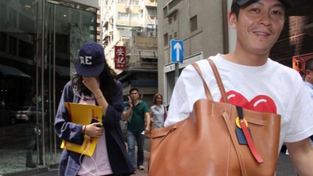 陈冠希和秦舒培离开酒店 愤怒反拍记者还竖中指