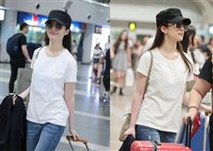 刘亦菲现身机场露灿笑