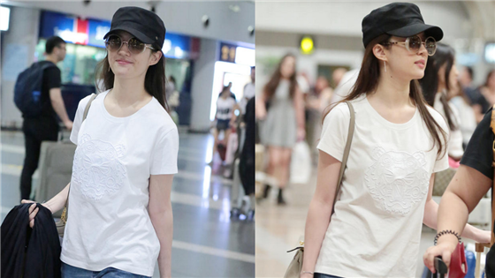 刘亦菲现身机场露灿笑 穿着白T也有仙气