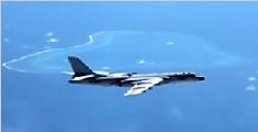 中国空军机群赴南海多个岛礁常态化战巡