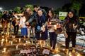 印尼民众点蜡烛游行 抗议政府将处死14名毒贩