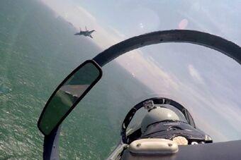 空军轰6K苏30等战机赴南海战巡黄岩岛