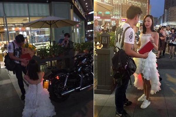 90后美女骑哈雷拿房产证 街头上演浪漫求婚