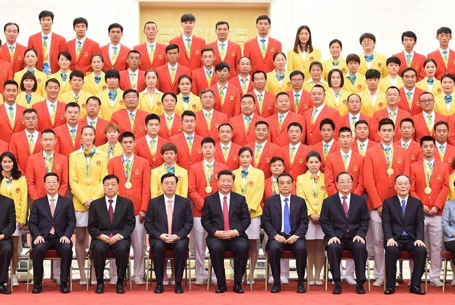 习近平等会见第31届奥林匹克运动会中国体育代表团全体成员