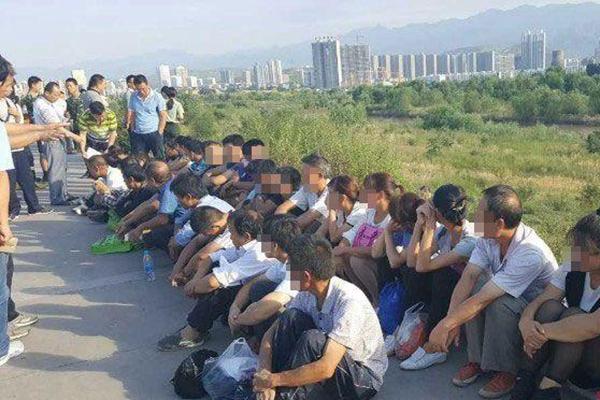 传销组织藏河滩树林授课 上游泄洪致36人被困