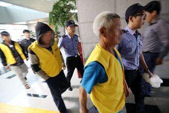 中国渔船幸存船员被韩海警带走调查