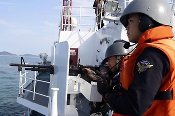 韩海警对中国渔船执法首次使用机枪射击