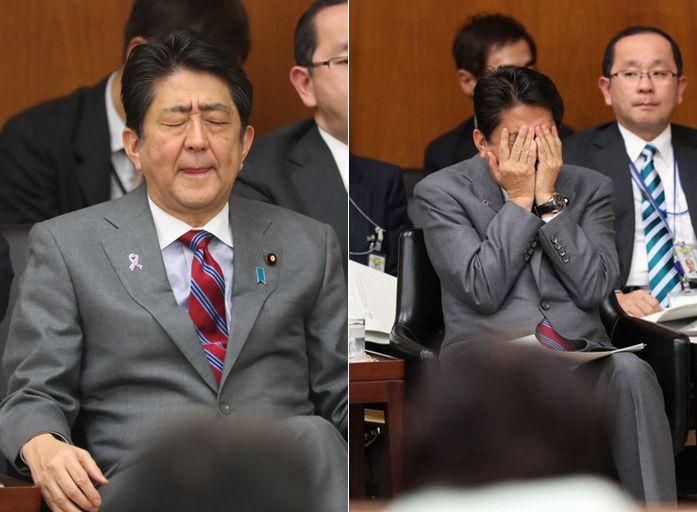日本强行通过养老金改革法案 安倍接受质问双手捂脸图片