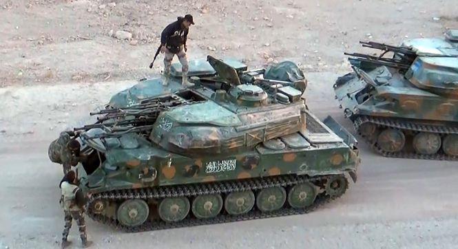 叙利亚反政府武装撤出大马士革小镇 投降上交军事装备