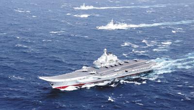 飞遍四大海域!中国歼15战机首次在南海起降航母