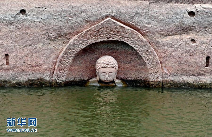 """江西一水库发现摩崖造像 """"佛头""""遗迹浮出水面"""