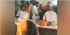 实拍理发师在顾客头上点火烫发 客人一脸享受