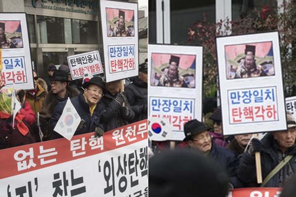 """韩朴槿惠支持者举""""包青天""""头像集会 抗议总统弹劾案"""