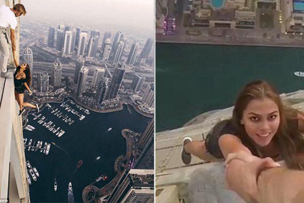 """女模拽男子手在310米高楼""""荡秋千"""""""